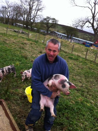 Farmer Richard Wilson likes to cuddle his piggies!